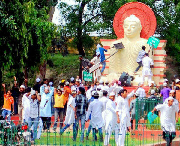 Muslims damaging Buddha statue in park
