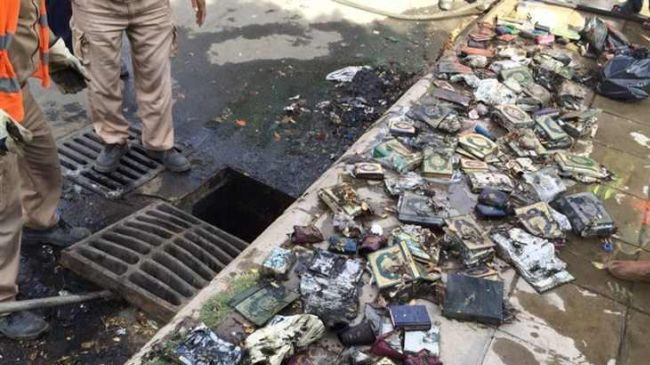 The photo shows copies of Quran retrieved from Taif sewerage canals.