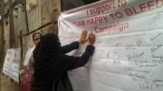 Muslim woman signing