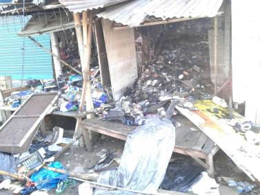 Shops damaged in rioting after death of Rohit Tanti
