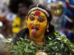 A woman dressed as Goddess Mahakali performs a procession of Bonalu festival in Hyderabad. AP/Mahesh Kumar A Telangana
