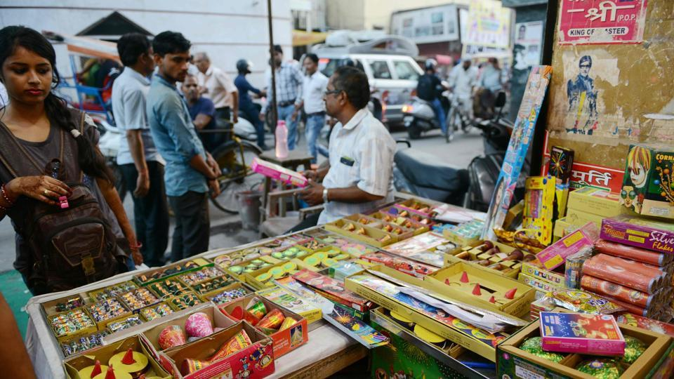 A woman looks on at a shop selling firecrackers in New Delhi on October 9, 2017.