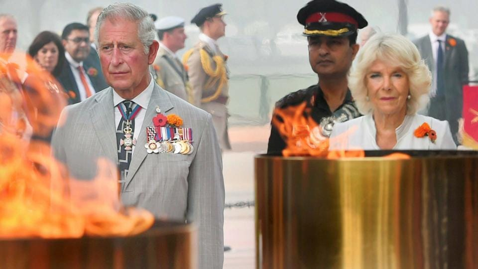 Britain's Prince Charles and his wife Camilla, Duchess of Cornwall pay homage at Amar Jawan Jyoti, India Gate, in New Delhi on Thursday.