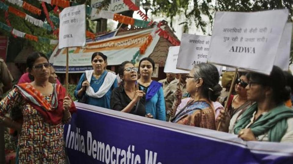 An activist of All India Democratic Women's Association (AIDWA) speaks during a protest against the rape and murder of a Dalit woman in Kerala in New Delhi on May 4, 2016