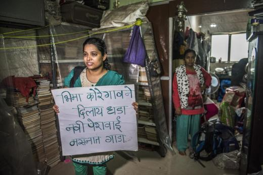 Dalit activists associated with the 'yalgar parishad' holding a protest placard at Sudhir Dhawale's office in Govandi after the Mumbai police arrested him there.