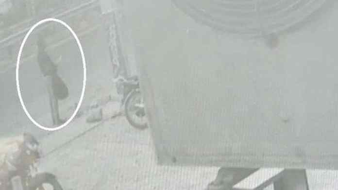 A man suspected to be Vikas Dubey outside a shop in Faridabad, ANIquoting police sources.