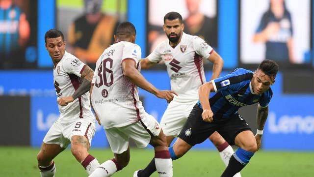 Soccer Football - Serie A - Inter Milan v Torino - San Siro, Milan, Italy - July 13, 2020 Inter Milan's Lautaro Martinez in action with Torino's Bremer, as play resumes behind closed doors following the outbreak of the coronavirus disease (COVID-19) REUTERS/Daniele Mascolo