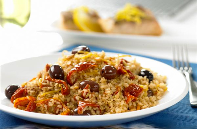 image of brown rice with sun dried tomatoes, olives and pine nuts