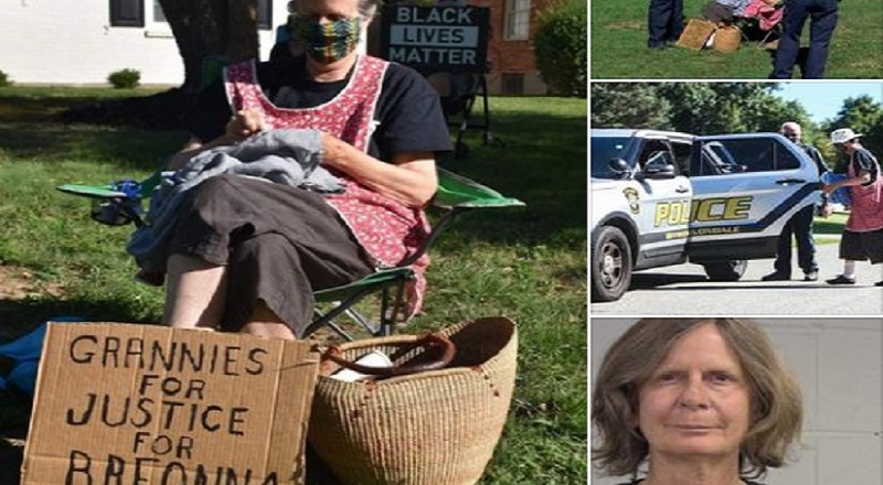 Thomas Merrill, on Facebook, shared photos of a white woman, Mary Holden, getting arrested. The 68-year-old woman is demanding justice for Breonna Taylor. She is doing more than most, camping out in the yard of the Kentucky Attorney General, Daniel Cameron, demanding he further investigate the murder of Breonna Taylor, leading to her arrest for third degree criminal trespassing.