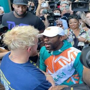 Floyd Mayweather Jake Paul hat fight faceoff