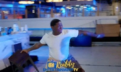 Yung Joc throws a chair and swings on his son