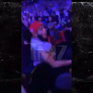 6ix9ine tries to fight fan who throws a can of beer at him
