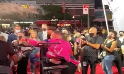Conor McGregor threw a drink at Machine Gun Kelly, on the VMAs red carpet, and also tried to punch him