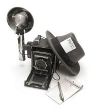 press hat and camera