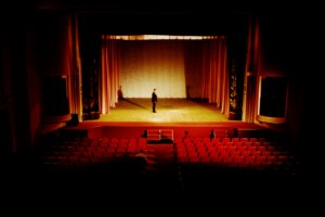 empty opera hall one man on stage