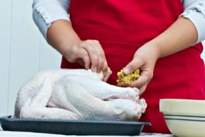 woman stuffing a turkey