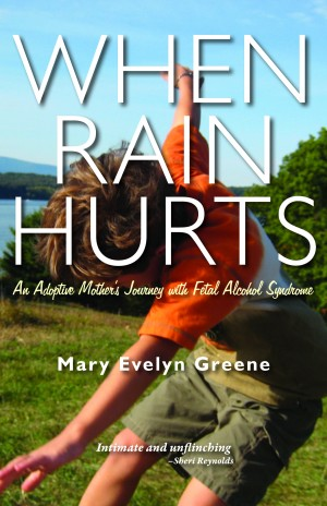 cover of when rain hurts boy in grass spinning around underneath clear blue sky