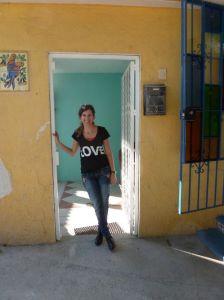karen lentz in doorway of colorful room