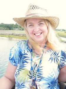 wendy thornton wearing sun, straw hat by fresh water