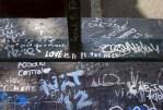 abbey road graffiti on pavement