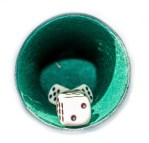 vintage yahtzee cup lined with felt with dice inside looking in