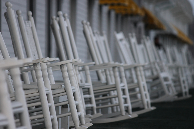close up of empty rocking chairs on porch of grand hotel mackinac island
