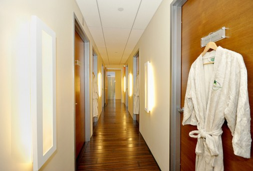 fitting room hallway one robe hanging up on a door