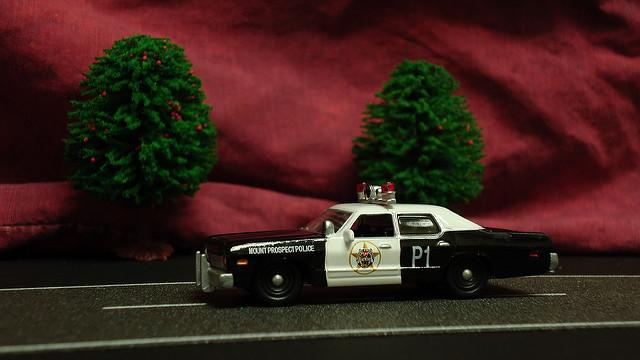toy cop car in diaroma display