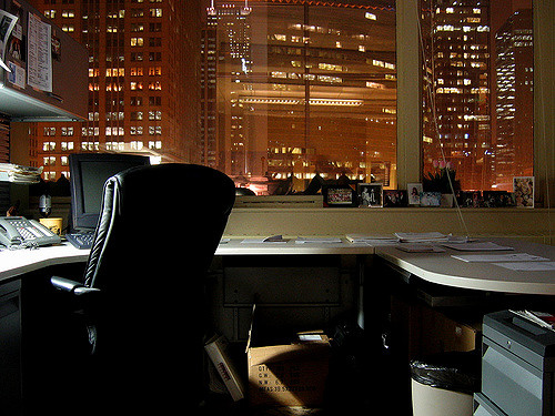 corner office, empty, in the evening looking out to city