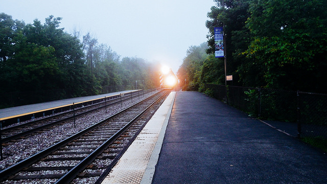 railroad tracks with train approaching
