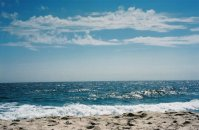 ocean meets sky, horizon - sand and waves in forefront