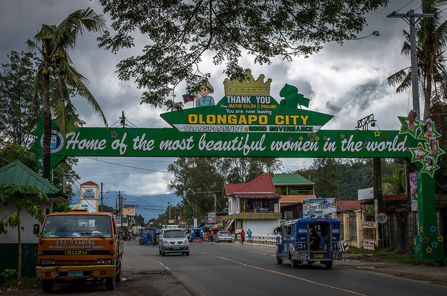 "welcome sign to city that says ""home of the most beautiful women"""