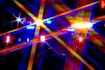 abstract of close-up of flashing lights - rays of blue, red, yellow and purple