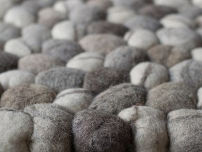 close-up shot of small cotton wool balls in gray and offwhite