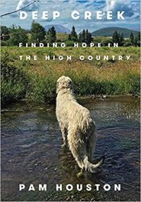 cover of hope in the high country; dog in creek with mountains behind