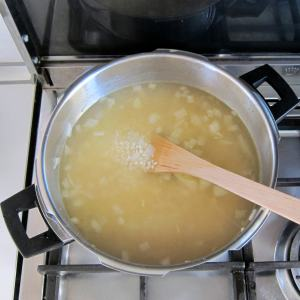 adding stock for pressure cooker risotto - before pressure cooking