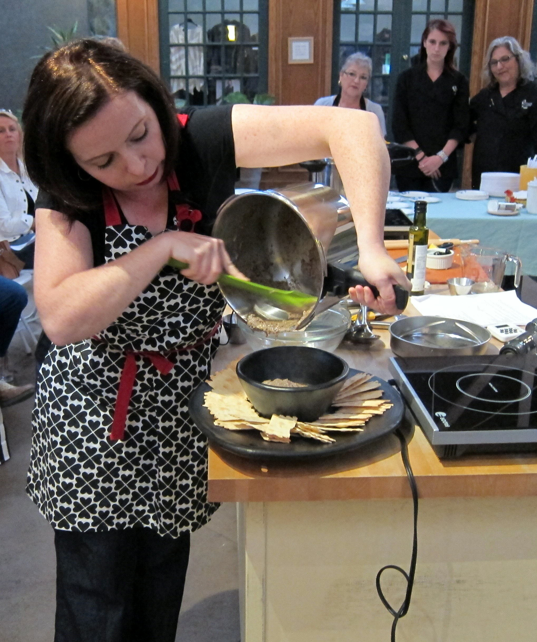 Laura shows her technique for holding a heavy pressure cooker tilted while pouring out the contents