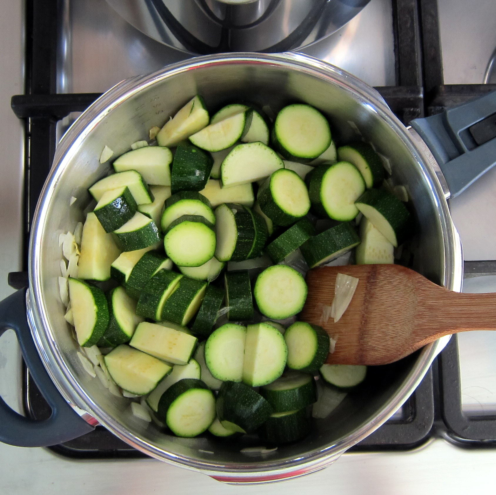 Add zucchini, salt and water.