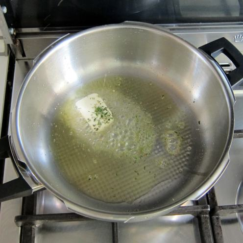 To pre-heated pressure cooker add oil, butter and finely chopped rosemary.