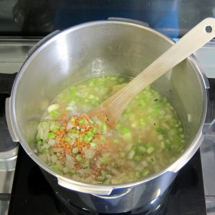 Add soaked lentils and vegetable broth and pressure cook.