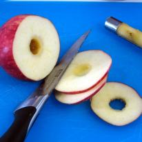 Core and slice apple to desired thickness.