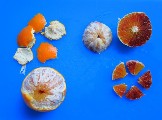 Peel, slice and cut orange for salad wedges