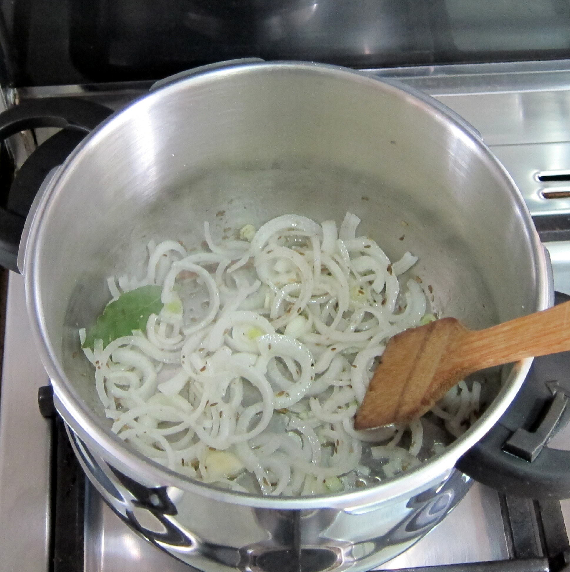 Add onions and saute until just starting to brown.