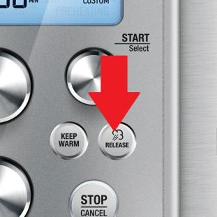 Arrow points to button to push for setting opening method or releasing pressure.