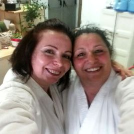 Laura and Susanna- in their karategi after Shotokan Karate' belt exam.