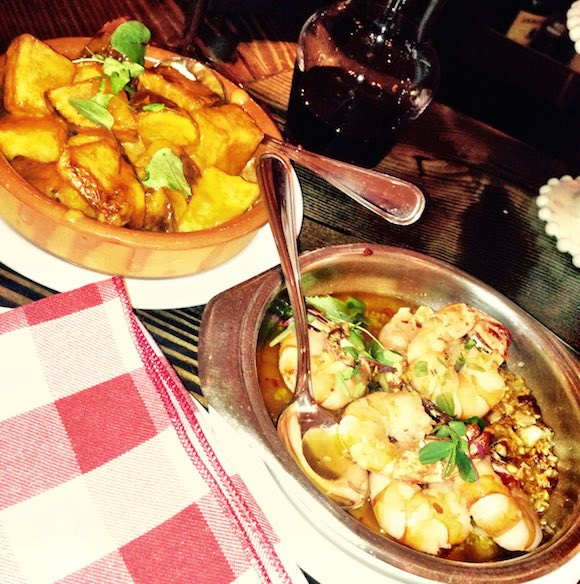 Patatas Bravas and Gambas—tapas mainstays for over 40 years