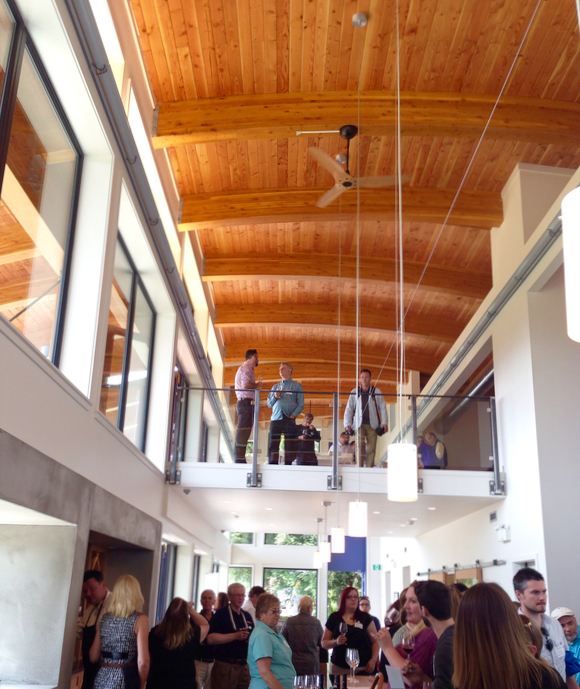 Blue Grouse main tasting area, showing the mezzanine and warm, wood ceiling