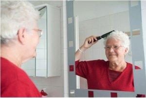 elder woman brushing her hair