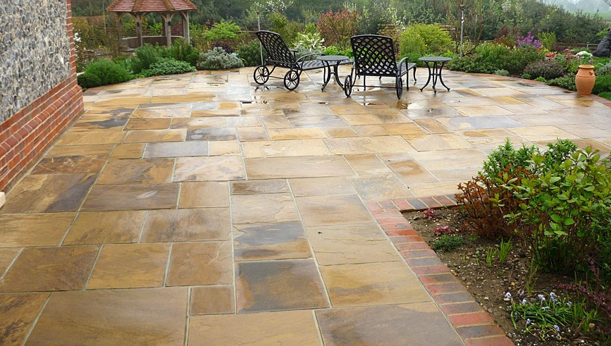 How to build a stone patio on your own   HireRush Blog natural stone patio with garden furniture