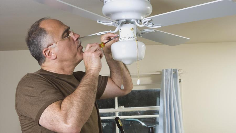 8 Steps of How to Install a Ceiling Fan   HireRush     electrician installing a ceiling fan